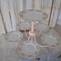 Up cycle chandelier to cake stand...needs darker color and non-flowery plates.