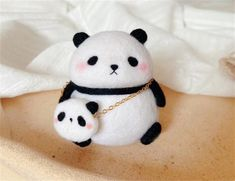 This cute panda felting kit is perfect for beginners, its easy and quick for beginners to follow. Needle felting is the process of transforming wool into 3D objects using a barbed needle. The best thing is, no previous wool felting, sewing, knitting, or crocheting experience/skills are necessary to Needle Felting Kits, Wool Felting, Beginner Felting, Computer Bags, Cute Panda, Cool Watches, Hello Kitty, Cute Animals, Sewing