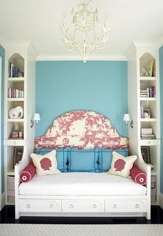 Blue, pink, and white bedroom.  Daybed as an extension of built-in shelving makes an interesting architectural statement in this narrow room.