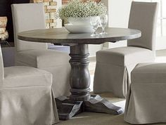 Progressive Muses Round Dining Table P836-13T+13B - Progressive Muses Round Dining Table P836-13T+13BThis dining set has today's look. A beautiful Large pedestal round table with wonderful grey/brown finish is enhanced with your choice of matching soft seat wooden back chairs or lace backed parsons chairs. The table is scrubbed Oak veneer with a great grey hang-up. The table base is constructed of hard rubberwood. The Chairs are solid rubberwood with poly covered soft seats or comfortable…