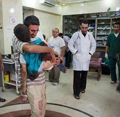 A father hugs his killed son a last hug after he was killed by Israeli Occupation Force.