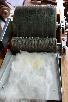 Using a drum carder - part 2, carding raw fleece great tutorial on the website for telling when a bad needs to go back through the carder because the fibers are not alligned.