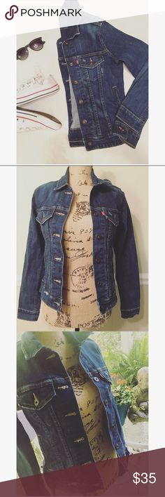 Levi's Trucker Denim Jacket Levi's dark wash denim jacket. Size small in petites. Has two breast flap pockets and one distressed rip on the side. GREAT CONDITION. Selling for less on Merc Levi's Jackets & Coats Jean Jackets