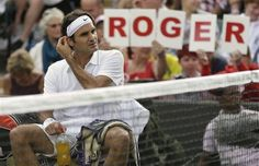 Roger Federer of Switzerland rests between sets during a first round men's singles match against Albert Ramos of Spain at the All England Lawn Tennis Championships at Wimbledon, England, Monday, June 25, 2012. (AP Photo/Tim Hales)