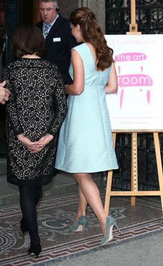 Catherine, Duchess of Cambridge enters The National Portrait Gallery with Art Room charity founder Juli Beattie on April 24, 2013 in London, England.