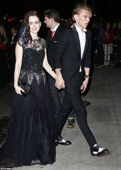 2013 met gala.  Rising stars: British couple Lily Collins and Jamie Campbell Bower kept on their ball outfits as they joined the party at the Standard