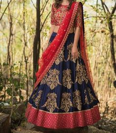 Beautiful royal blue color lehenga and red color designer blouse with red color net dupatta. Lehenga and blo use with hand embroidery gold thread and zardosi work. Meenakshi collection of Mrunalini Rao . Half Saree Lehenga, Lehenga Style, Red Lehenga, Lehenga Blouse, Indian Lehenga, Choli Designs, Lehenga Designs, Blouse Designs, Saris