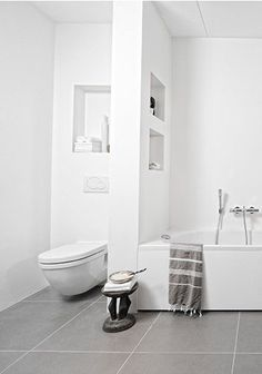 like the large tiles floor, separation between toilet and rest of the bathroom