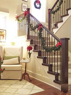 twist together 2 cheaper garlands for a fuller look. attach to stairs using florist wire