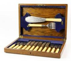1069 - Set of English Fish Servers Set of English fish serving knife and fork, having a wooden case. Provenance: from the home of a retired professional woman who lived in London, England during World War II.  EST: $200 - $400 May 7th Estate Auction | Official Kaminski Auctions