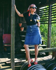 T-Shirt, denim skirt, sandals and chic accessories | Photo by Carelia (@myevolvingstyle) | For more style inspiration visit 40plusstyle.com