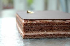 The classic opera cake is contained of joconde sponge cake, coffee buttercream, chocolate ganache, coffee syrup and chocolate glaze. In this class, you'll learn. Opera Cake, Coffee Buttercream, Ganache Cake, French Cake, Nutella Brownies, Baking Classes, Plum Cake, Classic Cake, Chocolate Glaze