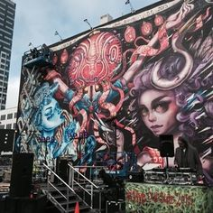 @lolo_ys putting the finishing in her mural with @caratoes and @tatunga at the corner of Van Ness and Market in San Francisco.