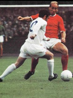 Leeds United's Johnny Giles takes on Bobby Charlton of Manchester United