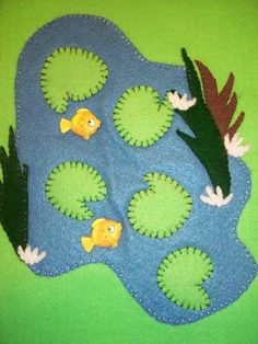 Felt book page. Button fish! Great to do a Krsna felt book can put him and friends on each page