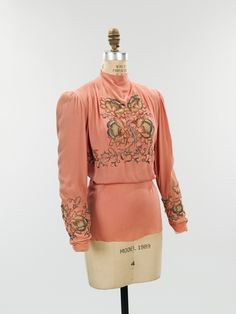 """evening blouse ca. 1940 via The Costume Institute of The Metropolitan Museum of Art """"Schiaparelli often used embroidery to embellish her simple silhouettes. This evening blouse from the summer 1940 collection, one of the last before Schiaparelli was..."""