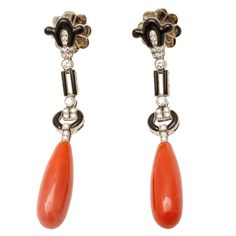 A pair of white gold onyx, coral and diamond pendent earrings | From a unique collection of vintage dangle earrings at http://www.1stdibs.com/jewelry/earrings/dangle-earrings/