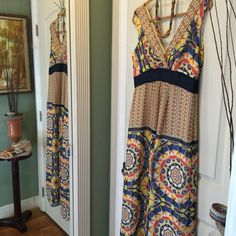 Geo tribal vibe Maxi NEWListing  Colorful Goe tribal vibe print on this maxi dress give it lots of personality in colors of navy orange and yellow dry clean fully lined  made of 100.% polyester has deep V neckline in both front and back by Ann Taylor super lightweight with wide straps flows as you walk back v has a pinhole and color smudge see last photo Ann Taylor Dresses Maxi