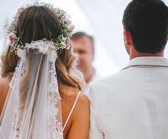 Amp up the romantic vibes by incorporating a bit of lace into your wedding veil. For boho flair, wear it with a flower crown!