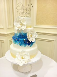 Watercolor wedding cake with blue and gold, by Amy Hart