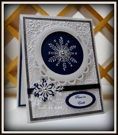~ Peace on Earth ~   Serene Snowflakes, sentiment is computer generated Paper: GP White, Night of Navy Ink: Versamark Accessories: silver 1/2 pearls, nesties, oval punch, scalloped oval punch, embossing folder, 1/4 inch navy ribbon, snowflake punch, branch punch, dimensionals, white embossing powder
