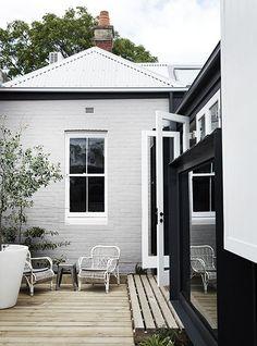 Whiting Architects - OGrady - brick, white trim, black steel, oak colour boards