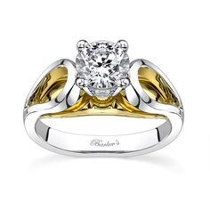 Two tone solitaire engagement ring - 7607LW - A stunning two tone diamond engagement ring that makes a statement of elegance, featuring cathedral shoulders  that rise to the prong set center diamond.  Pear shape openings grace the shoulders and a bright polished yellow gold gallery adds a dramatic look.    Also available in yellow gold, 18k and Platinum.