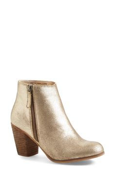 Swooning over this gorgeous gold bootie that is sure to make a statement.