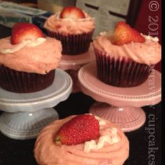 cupcravery cupcakes | 'flavor bomb' cupcakes -- dark chocolate cupcakes encased with a mini cheesecake topped with a fresh strawberry buttercream frosting | 04.24.12