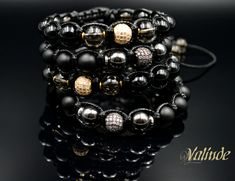 Beaded Gemstone Bracelets with Cubic Zirconia bead in the middle.
