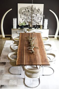 Walnut live edge dining table, faux elephant tusks, Flos chandelier + chrome Thonet dining chairs || Tompkins Lloyd Interiors
