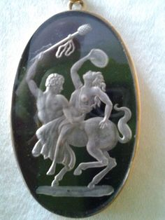 """""""This is a pendent from my mother.  She received it in 1943 from her Aunt.  It is about 1 1/2 inches long. The back is solid black onyx. It ..."""