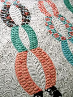 """Connie's Quilt """"Urban Chained"""" by Sew Kind of Wonderful, via Flickr Figure 8's swirls feathers, repeated."""