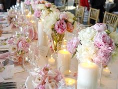 Bridal table full of pillar candles, peony arrangements and of course the bouquets.