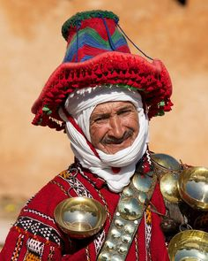 A Moroccon water seller in his traditional costume. Morocco has no particular rules and regulation about the clothing but the Moroccans have kept alive the custom to wear the traditional dress of Morocco. We Are The World, People Around The World, We The People, Luge, Folk, Cultural Diversity, African Countries, North Africa, Identity