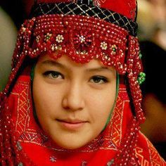 Karakalpak girl in traditional head-dress, Uzbekistan.