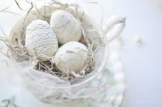 White lace eggs in a tea cup