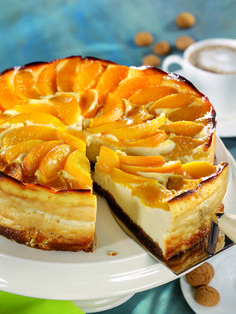 Sliced peaches top this beautiful cheesecake. Ground almonds add the texture and the graham cracker crust delivers the crunch.