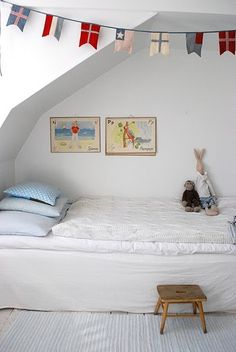 flags and using a sloped ceiling to create a little sleeping nook