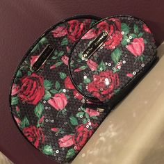 """Betsey Johnson cosmetic bags Pair of Betsey Johnson floral sequined cosmetic bags, zip top closure, excellent used condition, smoke free home, 10""""x7"""" and 6""""x4 1/2"""" Betsey Johnson Bags Cosmetic Bags & Cases"""