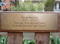 """p190: """"They had wandered as far as Soho Square during this conversation, and Clare pointed at a bench for them to sit on.  Andrew noticed the inscription on it, and smiled in recognition. Clare saw the smile, and explained """"I knew her, a little.  I often come here."""" Kirsty Maccoll, Soho, Conversation, Bench, Smile, Outdoor Decor, Small Home Offices, Desk, Bench Seat"""