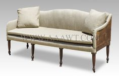 Early 19th Century rural New England sofa reupholstered for country decor. Dimensions: 74-inches long, 34.5-inches high, 25-inches deep. $6,950