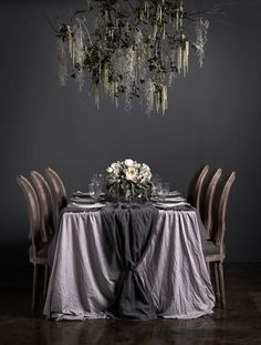 love this look from the chandelier to the table cloth.  Colors of cloth could be matched to Hogwart house colors.