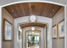 Barrel-vault archway all along the hall with wooden ceiling and three matching light fixtures. (by Canadian Specialty Ceilings; HomeStratosphere.com)