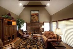 country-living-room-with-cathedral-ceiling-entertainment-center-and-brick-fireplace-i_g-IS9hv0uc1f67gb1000000000-kyd0W.jpg (900×600)