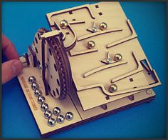 This flat-packed wooden toy will keep you occupied for hours as each turn of the crank unleashes an endless cascade of ball bearings. Its maker also offers another configuration, and expects them to go on sale soon.