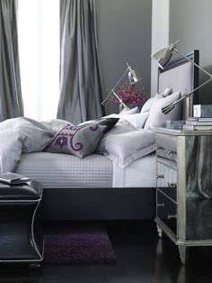 Silver, gray, and pops of purple create a regal, restful retreat.