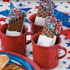 Best dessert that you can make!  Get ice cream sandwhiches,   Dip one end corner in sprinkles,   then another in white icing:)   yum!