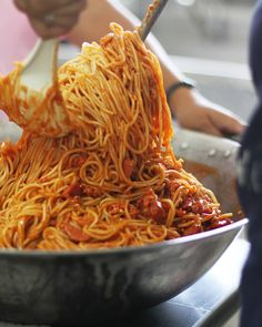 Filipino Spaghetti - Pinch of Yum // now, this looks interesting...but I admit I'm pinning because it calls for 2 cups of hot dogs as part of the meat....and that just makes me laugh.