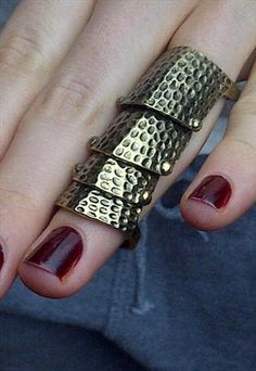 Bronze Armour ring  This punk chic Bronze embellished Armour ring is everywhere on the season catwalk.. whether on the red carpet or in you black skinny and hi tops.. this is a must have look.